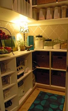 LOVE this pantry!! we don't have a walk in pantry...but i could do the tan/white wall treatment...so cute