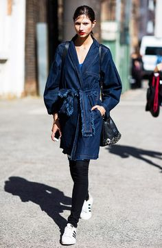 Frayed denim trench, skinny jeans, and Adidas