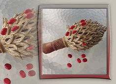 oversized magnolia seed pod with red seeds