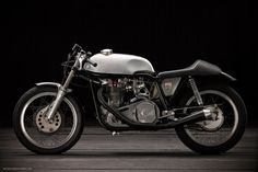 This beautiful machine, photographed by Benoit Guerry in France, has just been profiled on the (highly recommended) Southsiders site. It's a Triton-style hybrid, built in the 1970s from recovered parts and spares—including a Lowboy frame, shortened Norton Roadholder forks, a Seeley front brake, and a Triumph five-speed transmission. The engine is a rare 1957 pre-unit T100/RS with a splayed-port Delta head.    Read more: http://www.bikeexif.com/vintage-norton#ixzz1lfQyeMsw