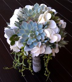 so very lovely. the trailing bits are succulents, too. a #bridal #bouquet that you can plant, this is winning. >> Wedding bouquet, by A Touch of Succulents