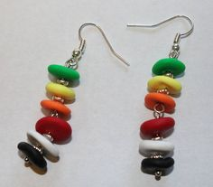 If youre a Chicago hockey fan, youll recognize these colors right away! Show your support for your favorite team with these lightweight, handmade fishhook polymer clay earrings. All beads are hand-smooshed, so no two are exactly alike. Silver findings and silver divider beads. Price includes shipping/handling.