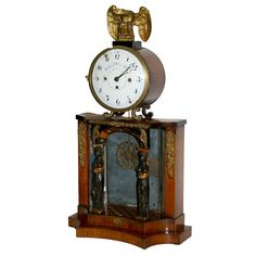 Early 19th Century Biedermeier Clock | From a unique collection of antique and modern clocks at https://www.1stdibs.com/furniture/decorative-objects/clocks/