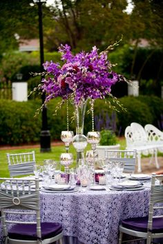 Beautiful purple and silver wedding! Silver spandex bands, rhinestone buckles, purple tablecloths and silver chemical lace overlays. www.cvlinens.com