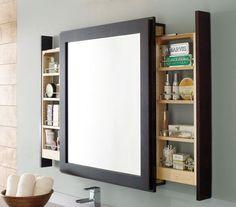 Foto: Estanteries dins es mirall. Aprofitar espai i amagar es trastos