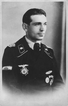 """Portrait of unidentified Panzer commander, 1944. Note the """"tank buster"""" sleeve badge."""