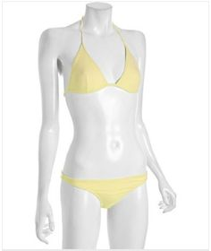 Light Yellow Triangle Halter Bikini by Dolce & Gabbana - Light colored bikinis really show off your tan. I've been working on mine; luckily it has been a mild winter in SoCal. I've gotten to the beach quite a few times already and it is only February.