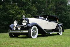 1931 DuPont Model H Merrimac Sport Phaeton - DuPonts were luxury cars built between 1919 - 1931. The Model H was a straight 8 cylinder car displacing 331 ci. This car was specifically built for the New York Auto Show in 1931. Only 3 Model H cars were built due to the Great Depression. Production was suspended until the economy got better but like so many other U.S. makes at the time they just ceased to exist. This one has a Lalique hood ornament and Trippe driving lights.