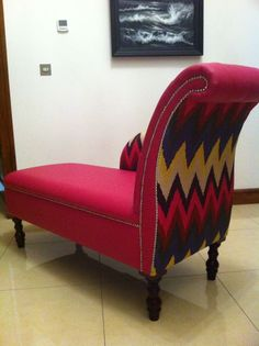 Chaise covered in cereal pink leather in Schumacher Chevron fabric.