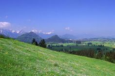 Germany, Romantic Road, Neuschwanstein, Field in a mountain range - Medioimages/Photodisc/Photodisc/Getty Images