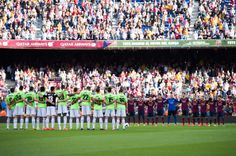 Players of FC Barcelona and CA Osasuna hold a moment of silence in respect to recently deceased former player of FC Barcelona Isidre Flotats during the La Liga match between FC Barcelona and CA Osasuna at Camp Nou on March 16, 2014 in Barcelona, Catalonia.