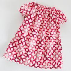 Make an adorable peasant dress with a sweet rick rack hem. Free printable infant/0-3m pattern.