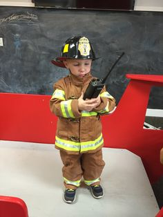 Our very own Lucas , the youngest firefighter on duty !
