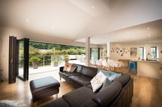 7 Bi folding doors open out onto the raised terrace overlooking the lush valley. Pet Friendly Holidays, Folding Doors, Beach Holiday, Architect Design, North Devon, Cottage, Contemporary, Luxury, Lush