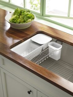 Riverby sink   This sink's accessories--a colander with cutting board, basin rack, glass-drying rack, and soaking cup--are ingeniously designed to speed up prep and cleaning tasks.
