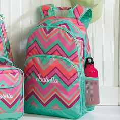 """As+cool+as+rainbow+gelato,+colorful+backpack+is+quality+constructed+of+silky+100%+polyester.+For+enhanced+embroidered+name;+specify+up+to+12+characters.  Also+available+without+name.+Backpack+is+curved,+padded+back+straps+for+comfort+and+support,+3+roomy+zip+compartments,+2+mesh+side+pockets,  and+padded+back+panel.+6+1⁄2""""+x+12""""+x+18""""H.  Specify+name+up+to+12+characters."""