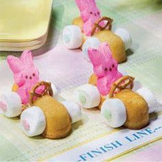 """Easter Bunny Race Cars Large Marshmallows, cut horizontally Bunny Peeps® Mini pretzels Cream-Filled Cakes (e.g. Little Debbie® Cloud Cakes™) Decorator Icing Frosting Sprinkles  Instructions Cut a small rectangle out of the top of the cream-filled cake about a third of the way back from the """"front"""" of the car. Use the white decorator icing to adhere the bunny Peep®, mini pretzel """"steering wheel"""" and large marshmallows in place. Use frosting and sprinkles to decorate your car. Allow to set."""