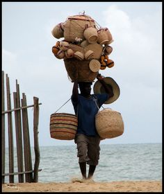 Basket Seller, Nigeria by Sheeju A I would love to meet this person walking down my street.