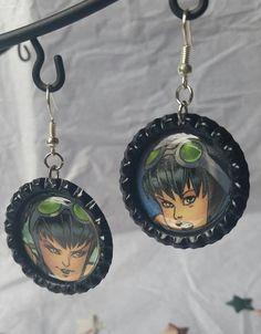 Cool comic book bottle cap earrings with DC comics' catwoman!  Selina Kyle is a kickass lady villain/love interest (it's complicated) of Batman.