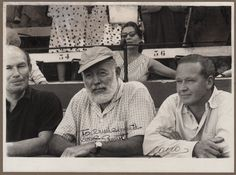HEMINGWAY ERNEST: (1899-1961) American Novelist, Nobel Prize winner for Literature, 1954. An engaging vintage signed and inscribed photograph, the image depicting Hemingway seated in a half-length pose within an arena, evidently a bull ring flanked by two other men. Photograph by the bullfight photographer Francisco 'Canito' Cano and signed ('Cano') by him with his name alone to a clear area at the base of the image. Signed by Hemingway in bold black fountain pen ink to a clear area of the…