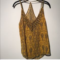 Beaded top from Urban Outfitters Mustard yellow beaded top with beautiful t back Urban Outfitters Tops Tank Tops
