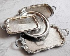 Accessories: Vintage Silver Butler Trays Old, tarnished beaten or battered . collect all the vintage silver trays that you can. Serve on them, display on them, put plants or knick-knacks on them. They add charm to any space. Silver Serving Trays, Silver Platters, Silver Trays, Silver Spoons, Silver Tray Decor, Serving Platters, Shabby Vintage, Vintage Silver, Antique Silver
