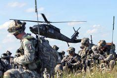 173rd Airborne Brigade paratroopers air assault through mock village during Saber Junction 14