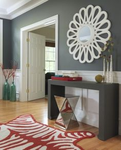 grey entry way w/ color splashes.