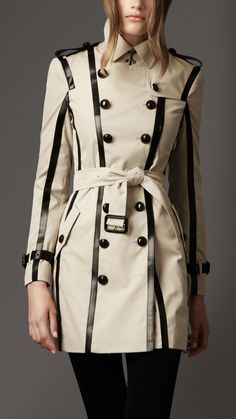 Burberry London women's Leather trim Trench Coat, Regimental Trench Coat with statement Leather trim, Metallic buttons engraved with the Burberry London logo Contrasting leather trim accentuates the slim silhouette, Hook and eye collar,slanted pockets, Leather epaulettes, gun flap, belted waist and Leather belted cuffs Rain shield-inspired leather trim back panel