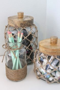 Beachy themed desk and dresser decor. Tweens shabby chic meets beachy themed bedroom. Glass jars with rope, very nautical...perfect for holding paints, and markers. Driftwood fish, and shell vase. Theraggedwren.blogspot.com