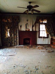 Living room inside abandoned mansion in Fairfax OK