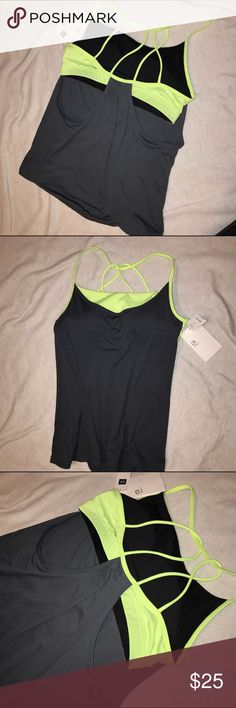 GapFit workout tank with built in neon sports bra Really cute double layer design gray workout tank, with strappy built-in neon yellow bra with removable padding. Never worn! GAP Tops Tank Tops