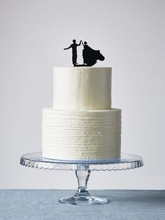 white cake with black silhouette