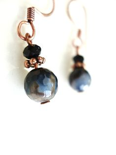 "Natural black agate with hints of gray and white pair beautifully with black crystals and copper  to create these chic, everyday earrings.   Total earring total length is 1-1/4""  (From top of earwires to bottom of stone.)  When it comes to natural stones, color and veining variations are boun..."