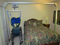 Freestanding Overhead Patient Lift for Home Health Care. Safe single caregiver operation.