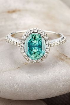 stunning teal colored stone engagement rings