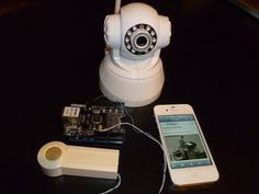 Notifying Doorbell with PushingBox.  Sends image of who's at your door to your smart phone or internet. Uses arduino-power :-)