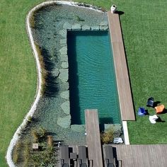 gardenriver:  Natural swimming pool. I want one, so much. Natural pools are filtered by plants, not chemicals.