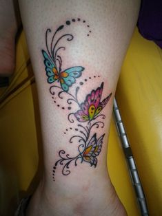 Nice Coloured Butterfly Tattoos On Wrist, really like this one