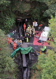 """(2) A major operation involving police, fire, mountain and cave rescue and Mines Rescue experts is launched to find the trapped men. South Wales Police superintendent Phil Davies says emergency services are conducting a """"difficult rescue operation""""."""