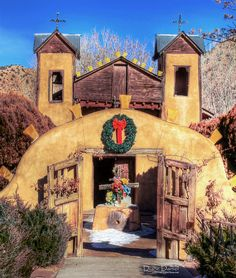 El Santuario de Chimayó, the famous little adobe Church in Chimayó, New Mexico, at Christmas time.