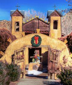 El Santuario de Chimayó, the famous little adobe Church in Chimayó, New Mexico, at Christmas time.