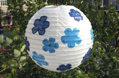 Make a paper lantern fit for a party by decorating it with paper napkins, Mod Podge and glitter.