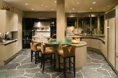 random pattern, gray stone floor, ultra modern kitchen with a center island