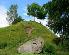 """February 25, 1336: """"The Defense of Margiris."""" Besieged by the Teutonic Knights and without hope, the Lithuanian fortress refused to surrender. Instead, they burned all their possessions, the castle, and every man, woman, and child in the fortress committed suicide. The inscription on the monument shown reads """" This is the grave of Margiris' giants! Though six ages passed, Like them -- just a handful of ashes! But tell more than the living. Photo by Wojsyl, under GNU Free Documentaion…"""