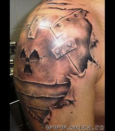 3d tattoo on the shoulder: armoured shoulder. This image doesn't belong to seiza.ro and is displayed for inspirational purposes only. For our collection of original tattoo designs visit the 'Original Designs for Tattoos' section.