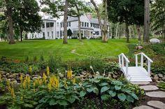 Private garden with a small stream, bridge and plenty of greenery [Design: Van Zelst] - Decoist  PLANTINGS!!