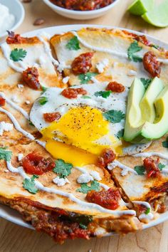 Quesadilla Huevos Rancheros -Mexican style breakfast with tortillas, eggs, refried beans and salsa ranchera, quesadilla style; I mean everything is better with melted cheese!