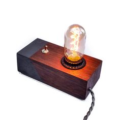 This beautiful American Black Walnut handmade desk edison lamp is 7 inches by 3 inches, and 2 inches high not including the height of the bulb, which is about an additional 3 inches. The speciality ed