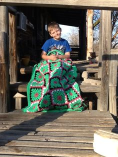 Nephew Bowdy and Penny lap blanket I made them. It is called the watermelon twist.